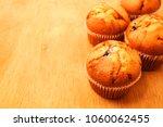 blueberry muffins over wooden... | Shutterstock . vector #1060062455