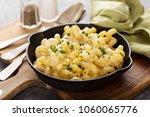 Small photo of Baked macaroni and cheese in a cast iron pan