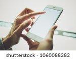 girl pointing finger on screen... | Shutterstock . vector #1060088282