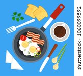 scrambled eggs fried in frying... | Shutterstock .eps vector #1060099592