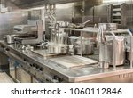 food being cooked in commercial ... | Shutterstock . vector #1060112846