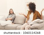 two female friends sitting on... | Shutterstock . vector #1060114268