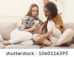 female friends using smartphone ...   Shutterstock . vector #1060116395