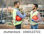 young builders shaking hands... | Shutterstock . vector #1060122722