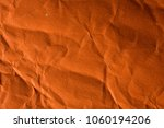 Small photo of Orange crinkle paper background.