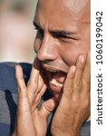 Small photo of Anxious Hispanic Male
