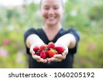a happy woman holding her fresh ... | Shutterstock . vector #1060205192