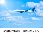 large jet airplane flying in... | Shutterstock . vector #1060219472