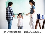 asian family renovating the... | Shutterstock . vector #1060222382