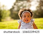cute little girl laughing and... | Shutterstock . vector #1060239425