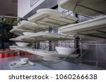 Stock photo deservicing conveyor belt for trays in a self service restaurant tray in a cafeteria on a belt 1060266638