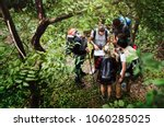 trekking together in a forest | Shutterstock . vector #1060285025