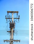 Small photo of High voltage power of electric transformer substation in summer.