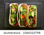 tacos with meat and vegetables... | Shutterstock . vector #1060310798