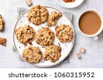 breakfast with healthy oatmeal... | Shutterstock . vector #1060315952