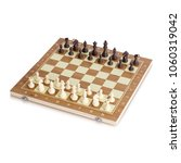 wooden chess board with chess... | Shutterstock . vector #1060319042