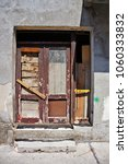 old timeworn shabby doors in... | Shutterstock . vector #1060333832
