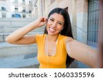 attractive latin woman in her... | Shutterstock . vector #1060335596