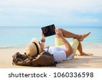 hipster traveler on the beach...   Shutterstock . vector #1060336598