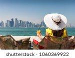 elegant woman enjoys the view... | Shutterstock . vector #1060369922