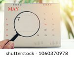 magnifying glass in hand on... | Shutterstock . vector #1060370978