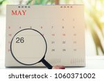 magnifying glass in hand on... | Shutterstock . vector #1060371002