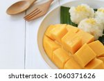 mango and sticky rice in white... | Shutterstock . vector #1060371626