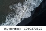 the black sand beach in iceland.... | Shutterstock . vector #1060373822