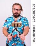 portrait of bearded tourist man ... | Shutterstock . vector #1060387808