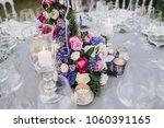 flower arrangement stands on... | Shutterstock . vector #1060391165