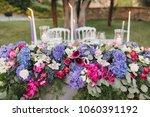 flower arrangement stands on... | Shutterstock . vector #1060391192