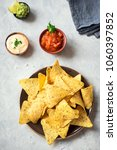 nachos chips and assorted dip... | Shutterstock . vector #1060397852