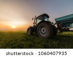 farmer with tractor seeding  ... | Shutterstock . vector #1060407935