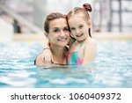 young girl and her mother... | Shutterstock . vector #1060409372