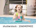 little girl with a water pistol ...   Shutterstock . vector #1060409402