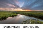 view over dairy farmland ... | Shutterstock . vector #1060409582