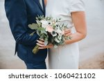 guy in suit and girl in white... | Shutterstock . vector #1060421102