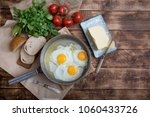 fried eggs in a frying pan with ... | Shutterstock . vector #1060433726