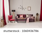 red armchair and wooden lamp... | Shutterstock . vector #1060436786