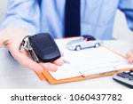 business man hand with keys and ... | Shutterstock . vector #1060437782