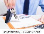 business man hand with keys and ... | Shutterstock . vector #1060437785