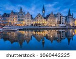 Panoramic view of famous Graslei in the historic city center of Ghent illuminated in beautiful post sunset twilight during blue hour at dusk with Leie river, Ghent, East Flanders, Belgium