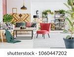 wooden table between a sofa... | Shutterstock . vector #1060447202