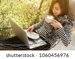 young woman having coffee in... | Shutterstock . vector #1060456976