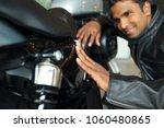happy indian biker wearing... | Shutterstock . vector #1060480865