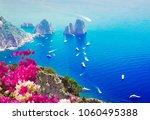 famous faraglioni cliffs and... | Shutterstock . vector #1060495388
