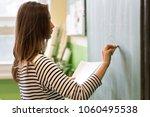 young female teacher or a...   Shutterstock . vector #1060495538