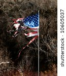 tattered america flag and pole