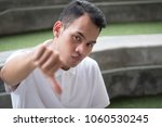rejecting man showing thumb... | Shutterstock . vector #1060530245