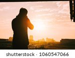 silhouette of a woman with... | Shutterstock . vector #1060547066